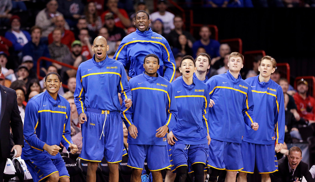. Players on Delaware\'s bench react as their team make a run against Michigan State in the first half during the second round of the NCAA college basketball tournament in Spokane, Wash., Thursday, March 20, 2014. (AP Photo/Elaine Thompson)