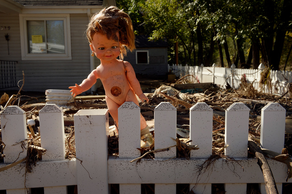 . A doll rests on a fence in Lyons,  CO September 20, 2013. Friday was the second day residents were allowed to return to their homes.  (Photo By Craig F. Walker / The Denver Post)
