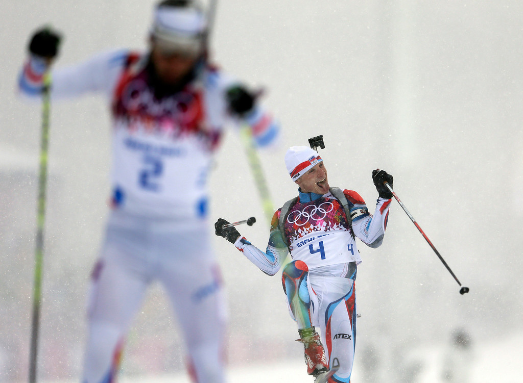 . The Czech Republic\'s Ondrej Moravec, right, celebrates winning the bronze medal next to silver medalist France\'s Martin Fourcade, during the men\'s biathlon 15k mass-start, at the 2014 Winter Olympics, Tuesday, Feb. 18, 2014, in Krasnaya Polyana, Russia. (AP Photo/Felipe Dana)