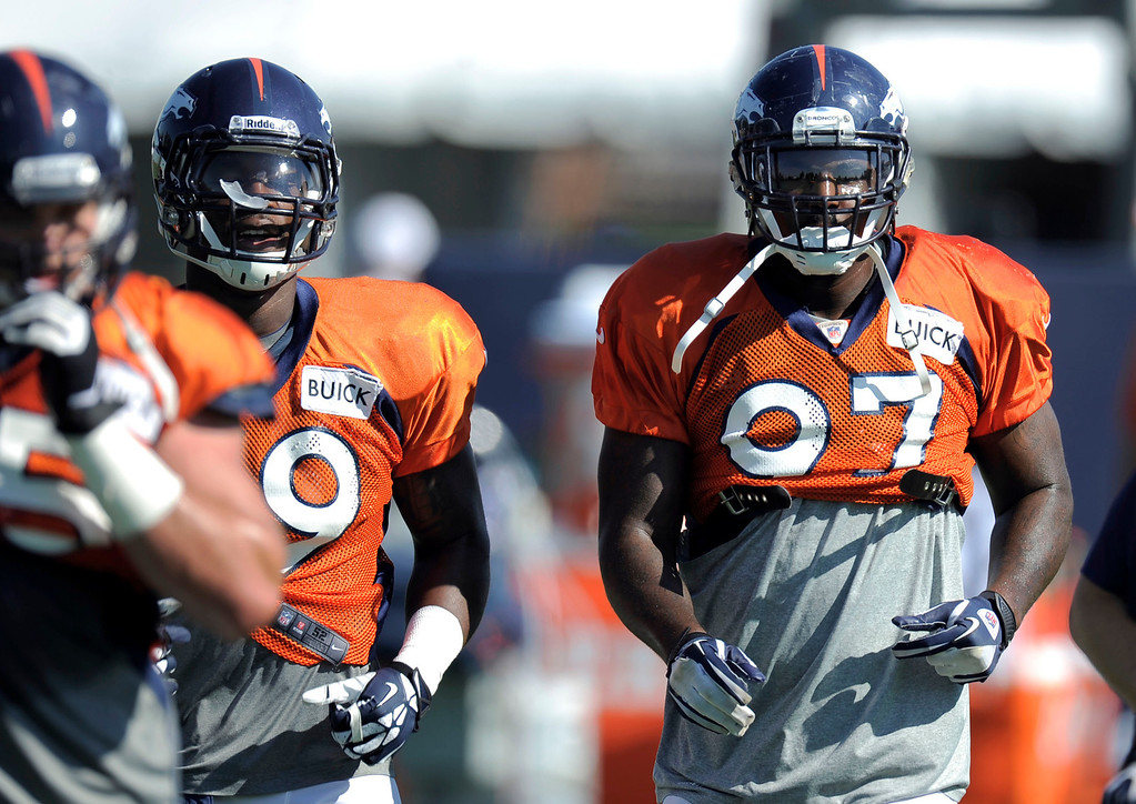 . Denver Broncos Malik Jackson (97) heads to drills during training camp August 13, 2013 at Dove Valley. (Photo By John Leyba/The Denver Post)