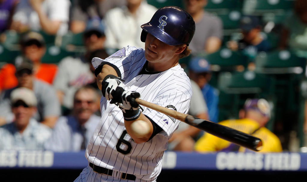 . Colorado Rockies\' Corey Dickerson swings at a pitch against the New York Mets in the first inning of a baseball game in Denver on Thursday, June 27, 2013. (AP Photo/David Zalubowski)
