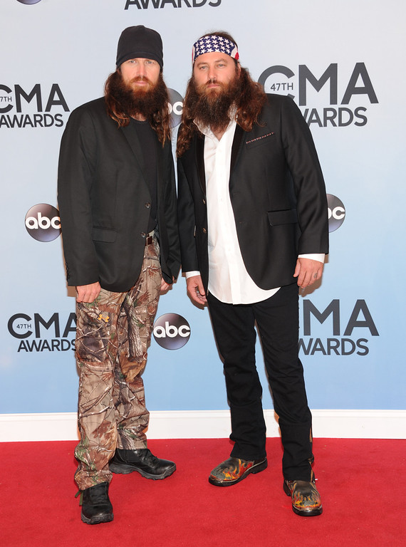 ". Brothers Willie Robertson, right, and Jase Robertson, of ""Duck Dynasty,\"" arrive at the 47th annual CMA Awards at Bridgestone Arena on Wednesday, Nov. 6, 2013, in Nashville, Tenn. (Photo by Evan Agostini/Invision/AP)"