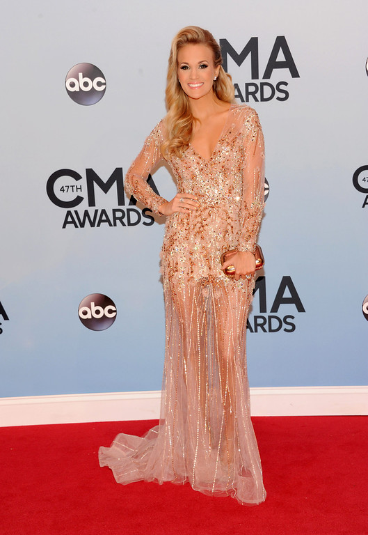. Carrie Underwood arrives at the 47th annual CMA Awards at Bridgestone Arena on Wednesday, Nov. 6, 2013, in Nashville, Tenn. (Photo by Evan Agostini/Invision/AP)