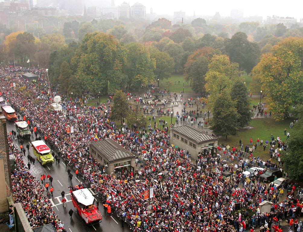 . Vehicles carrying the the World Series Champion Boston Red Sox move down Tremont Street alongside Boston Common during a parade honoring the Champions in Boston Saturday, Oct. 30, 2004. (AP Photo/Winslow Townson)