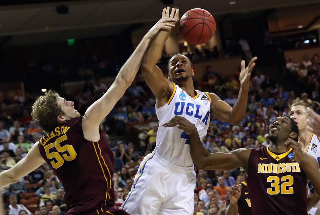 . AUSTIN, TX - MARCH 22:  Norman Powell #4 of the UCLA Bruins takes a shot over Elliott Eliason #55 and Trevor Mbakwe #32 of the Minnesota Golden Gophers during the second round of the 2013 NCAA Men\'s Basketball Tournament at The Frank Erwin Center on March 22, 2013 in Austin, Texas.  (Photo by Stephen Dunn/Getty Images)