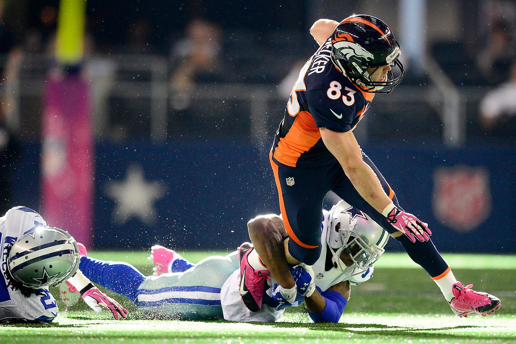 . Brandon Carr (39) of the Dallas Cowboys tackles Wes Welker (83) of the Denver Broncos during the second half of the Broncos\' 51-48 win at AT&T Stadium. (Photo by AAron Ontiveroz/The Denver Post)