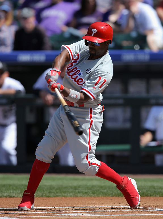 . Jimmy Rollins #11 of the Philadelphia Phillies hits a solo home run off of starting pitcher Juan Nicasio #12 of the Colorado Rockies to take a 1-0 lead in the first inning at Coors Field on April 20, 2014 in Denver, Colorado.  (Photo by Doug Pensinger/Getty Images)
