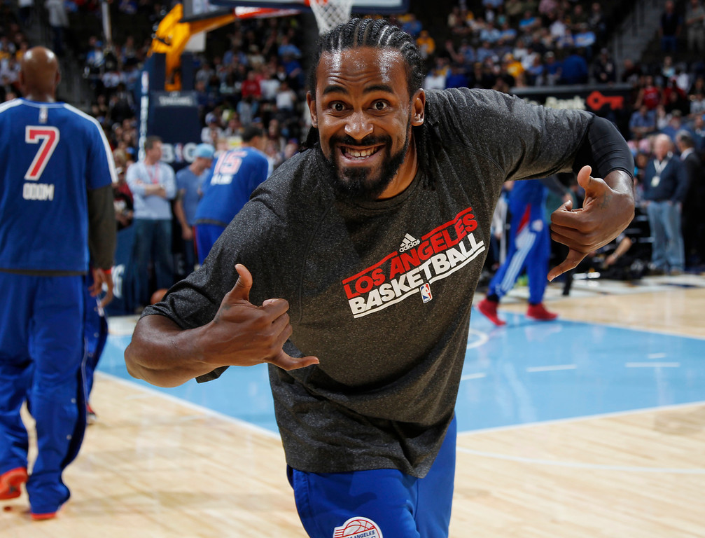 . Los Angeles Clippers center Ronny Turiaf jokes with photographers while warming up before facing the Denver Nuggets in the first quarter of  an NBA basketball game in Denver, Thursday, March 7, 2013. (AP Photo/David Zalubowski)