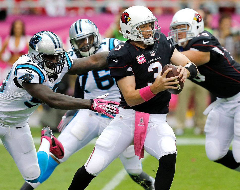 . Arizona Cardinals quarterback Carson Palmer (3) is pressured by Carolina Panthers outside linebacker Thomas Davis, right, and Greg Hardy (76) during the first half of a NFL football game, Sunday, Oct. 6, 2013, in Glendale, Ariz. (AP Photo/Ross D. Franklin)