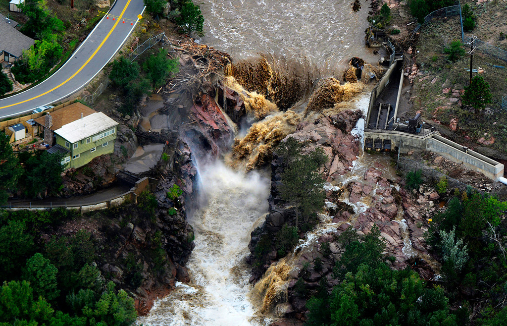 . The Big Thompson River rages through the washed-out Loveland Water Storage Reservoir in Larimer County, Colo. on Sept. 14, 2013.