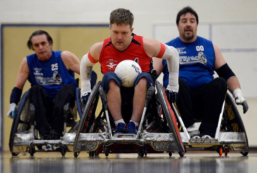 . DENVER, CO. - FEBRUARY 10:  Adam Scaturro (4) of the Denver Harlequins heads down court for a score as he gets chased by Dave Nicholls (00) and Weasel Luxembourger (25) during the Wheelchair Rugby Tournament February 10, 2013 at Englewood High School.  The Mile High Mayhem was put on by Craig Hospital and city of Englewood.(Photo By John Leyba/The Denver Post)