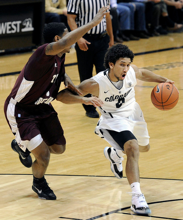 . University of Colorado\'s Askia Booker drives the ball past Madarious Gibbs during a game against Texas Southern on Tuesday, Nov. 27, at the Coors Event Center on the CU campus in Boulder.  Jeremy Papasso/ Camera