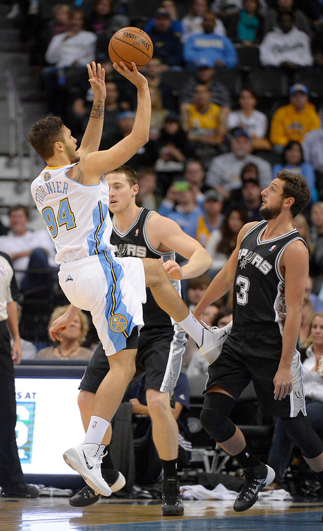 . Denver Nuggets shooting guard Evan Fournier (94) takes a shot over San Antonio Spurs shooting guard Marco Belinelli (3) during the first quarter October 14, 2013 at Pepsi Center. (Photo By John Leyba/The Denver Post)