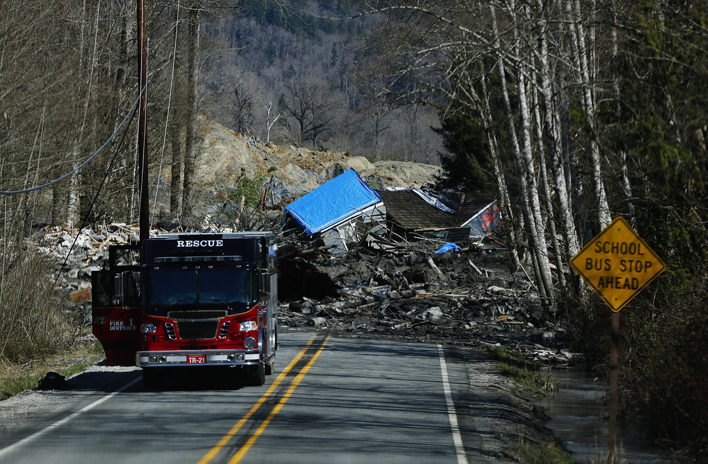 . A house sits destroyed in the mud on Highway 530 next to mile marker 37 on March 23, 2014 near Arlington, Washington.  (Photo by Lindsey Wasson/The Seattle Times-Pool/Getty Images)