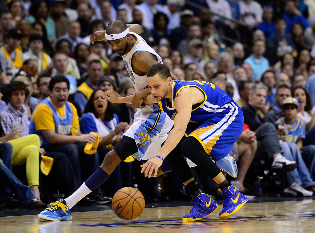 . Golden State Warriors point guard Stephen Curry (30) chases down a loose ball against Denver Nuggets small forward Corey Brewer (13). The Denver Nuggets took on the Golden State Warriors in Game 5 of the Western Conference First Round Series at the Pepsi Center in Denver, Colo. on April 30, 2013. (Photo by AAron Ontiveroz/The Denver Post)