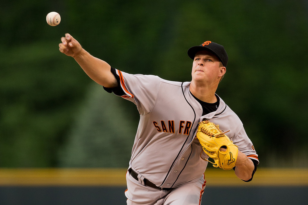 . Starting pitcher Matt Cain #18 of the San Francisco Giants delivers to home plate during the first inning against the Colorado Rockies at Coors Field on May 21, 2014 in Denver, Colorado. (Photo by Justin Edmonds/Getty Images)