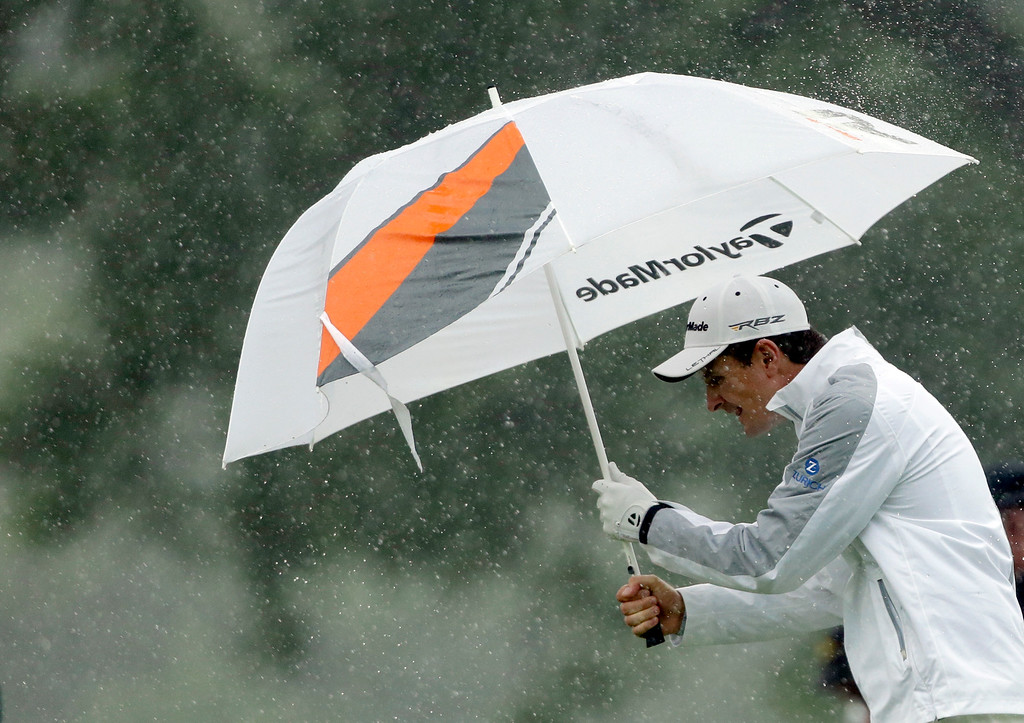 . Justin Rose, of England, walks up the 14th hole during the fourth round of the U.S. Open golf tournament at Merion Golf Club, Sunday, June 16, 2013, in Ardmore, Pa. (AP Photo/Julio Cortez)