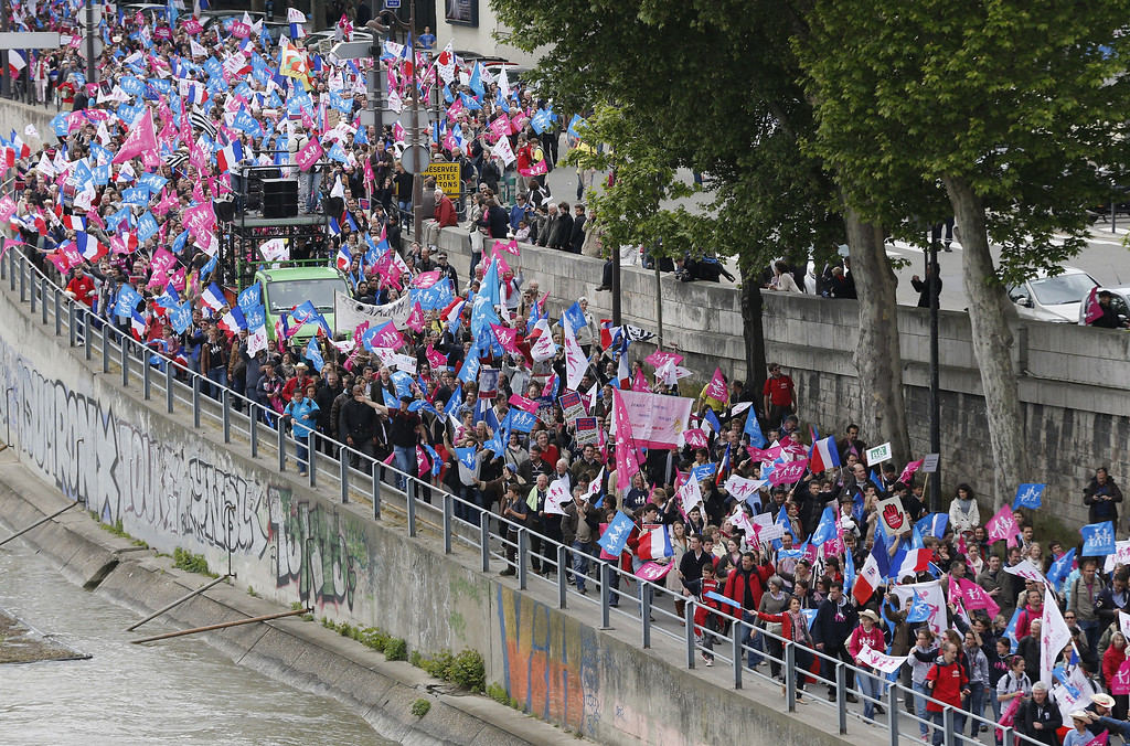 ". Supporters of the anti-gay marriage movement ""La Manif Pour Tous\"" (Demonstration for all) march along the Seine river bank during a mass protest on May 26, 2013, in Paris against a gay marriage law. France on May 18 became the 14th country to legalize same-sex marriage after President Francois Hollande signed the measure into law following months of bitter debate and demonstrations.   FRANCOIS GUILLOT/AFP/Getty Images"