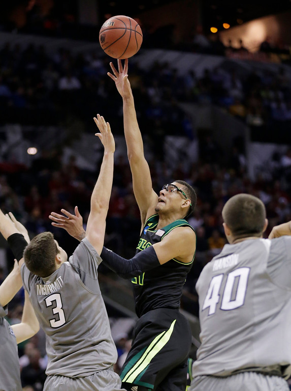 . Baylor\'s Isaiah Austin, center, shoots over Creighton\'s Doug McDermott (3) during the first half of a third-round game in the NCAA college basketball tournament Sunday, March 23, 2014, in San Antonio. (AP Photo/Eric Gay)