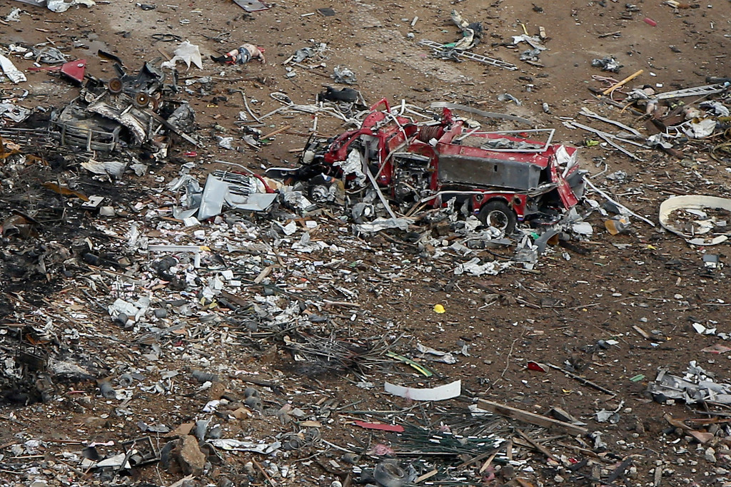 . WEST, TX - APRIL 18:  A destroyed fire truck sits among piles of rubble where an explosion at the West Fertilizer Company leveled the business a day earlier April 18, 2013 in West, Texas. According to West Mayor Tommy Muska, around 35 people, including 10 first responders, were killed and more than 150 people were injured when the fertilizer company caught fire and exploded, leaving damaged buildings for blocks in every direction.  (Photo by Chip Somodevilla/Getty Images)
