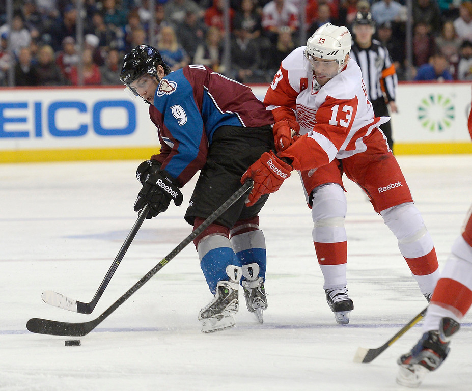 . Colorado Avalanche center Matt Duchene (9) battles with Detroit Red Wings center Pavel Datsyuk (13) for the puck during the first period October 17, 2013 at Pepsi Center.(Photo by John Leyba/The Denver Post)