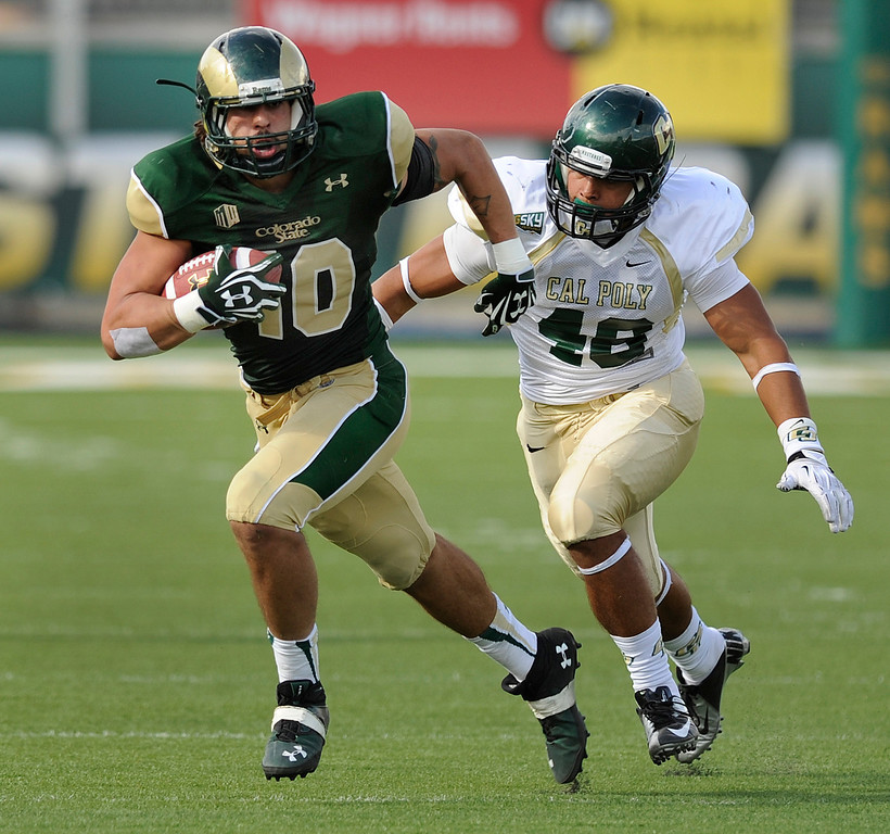 . FORT COLLINS, CO. - SEPTEMBER 14: Mustangs\' lineman Josh Josh Letuligasenoa (48) chased down Rams tights end Crocket Gillmore (10) in the second half. The Colorado State University football team defeated Cal Poly at Hughes Stadium in Fort Collins Saturday afternoon, September 14, 2013.  It was the Rams\' first home game and first win of the season. Photo By Karl Gehring/The Denver Post