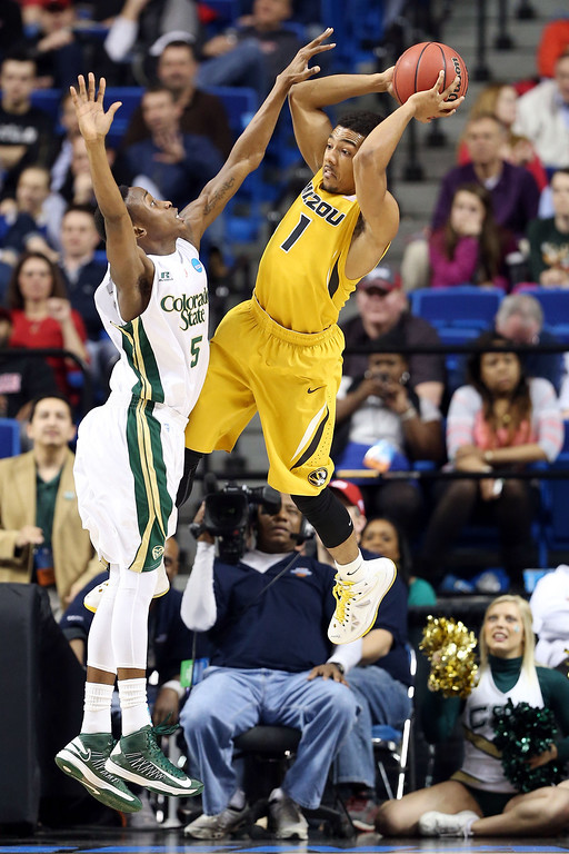 . LEXINGTON, KY - MARCH 21:  Phil Pressey #1 of the Missouri Tigers looks to pass the ball against Jon Octeus #5 of the Colorado State Rams during the second round of the 2013 NCAA Men\'s Basketball Tournament at the Rupp Arena on March 21, 2013 in Lexington, Kentucky.  (Photo by Andy Lyons/Getty Images)