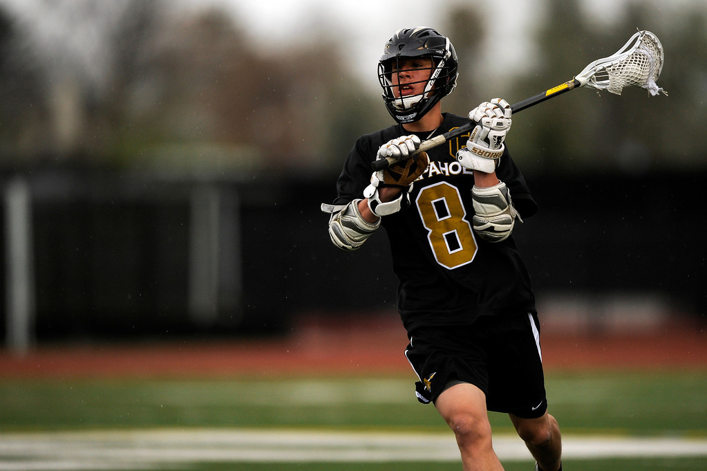 . DENVER, CO - MAY 15: Arapahoe senior midfielder Ben Eigner #8 looks to pass the ball against Regis Jesuit during a CHSAA 5A boys lacrosse semifinal on May 15, 2013, in Denver, Colorado. Arapahoe won 13-5 to advance to the finals. (Photo by Daniel Petty/The Denver Post)