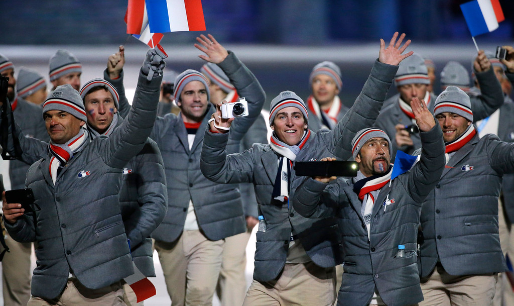 . Athletes from France wave to spectators as they arrive during the opening ceremony of the 2014 Winter Olympics in Sochi, Russia, Friday, Feb. 7, 2014. (AP Photo/Mark Humphrey)