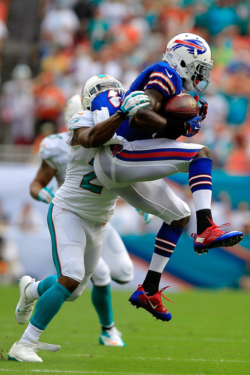 . T.J. Graham #11 of the Buffalo Bills (R) is tackled by Dimitri Patterson #24 (L) of the Miami Dolphins at Sun Life Stadium on October 20, 2013 in Miami Gardens, Florida.  (Photo by Chris Trotman/Getty Images)