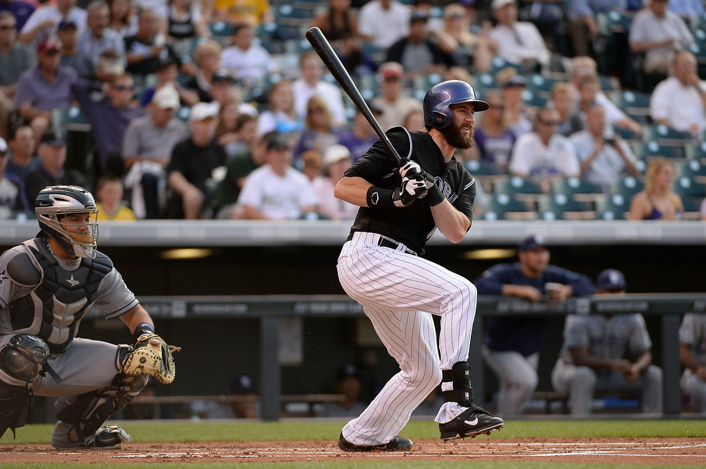 . Colorado Rockies center fielder Charlie Blackmon (19) watches his hit sail in to right field for a double during the first inning against the San Diego Padres July 8, 2014 at Coors Field. (Photo by John Leyba/The Denver Post)