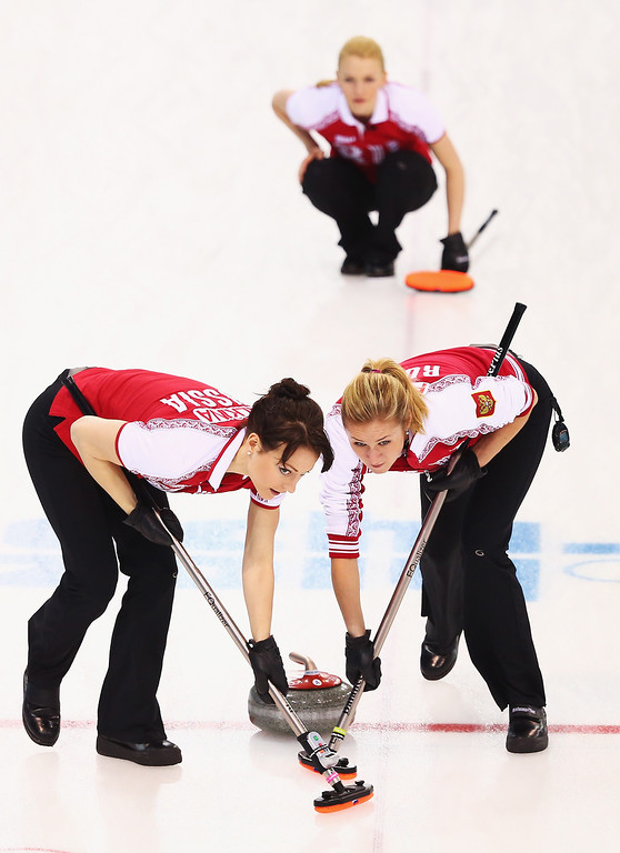 . Ekaterina Galkina and Margarita Fomina of Russia compete during the Curling Women\'s Round Robin match between Russia and Great Britain on day ten of the Sochi 2014 Winter Olympics at Ice Cube Curling Center on February 17, 2014 in Sochi, Russia.  (Photo by Ryan Pierse/Getty Images)