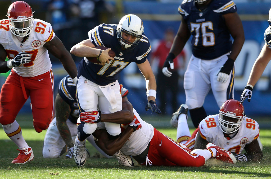 . San Diego Chargers quarterback Philip Rivers (17) is brought down by Kansas City Chiefs inside linebacker Akeem Jordan during the first half in an NFL football game, Sunday, Dec. 29, 2013, in San Diego. (AP Photo/Lenny Ignelzi)