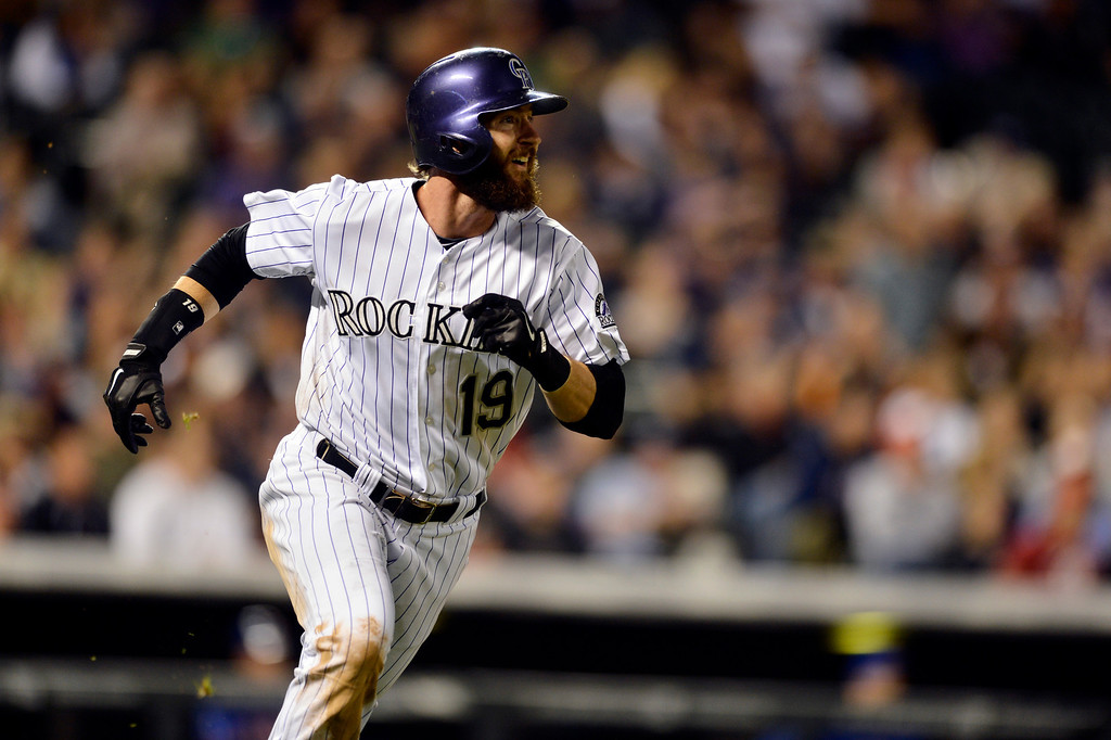 . Colorado Rockies\' Charlie Blackmon watches the flight of a solo home run against the New York Mets during the seventh inning of a baseball game, Friday, May 2, 2014, in Denver. (AP Photo/Jack Dempsey)