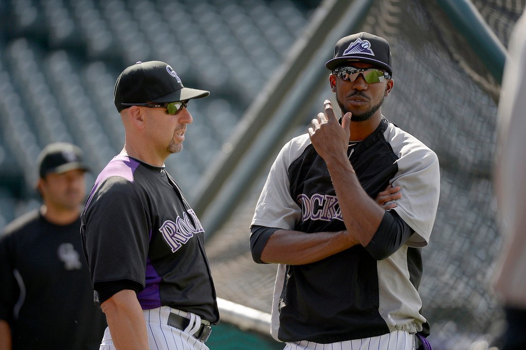 . Colorado Rockies manager  Walt Weis talks with Dexter Fowler during an open workout session for the fans July 18, 2013 at Coors Field. (Photo By John Leyba/The Denver Post)