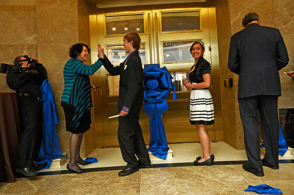 . DENVER, CO-May 02, 2013: Supreme Court Justice Sonia Sotomayor gives Caleb Kostreva, a homeschool  student from Clifton Colorado, a high five after cutting a ribbon on the doors of the new Judicial Learning Center, May 02, 2013. Sotomayor visited with students during a celebration to dedicate the new Ralph L. Carr Colorado Judicial Center in Denver. (Photo By RJ Sangosti/The Denver Post)