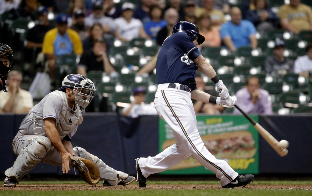 . Milwaukee Brewers\' Scooter Gennett hits a two-run home run during the eighth inning of a baseball game against the Colorado Rockies on Thursday, June 26, 2014, in Milwaukee. (AP Photo/Morry Gash)