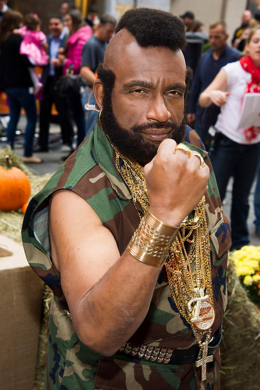 """. Al Roker dresses as B.A. Baracusm, portrayed by Mr. T, from the 80s series \""""The A-Team\"""" on NBC\'s \""""Today\"""" Halloween show on Thursday, Oct. 31, 2013 in New York. (Photo by Charles Sykes/Invision/AP)"""