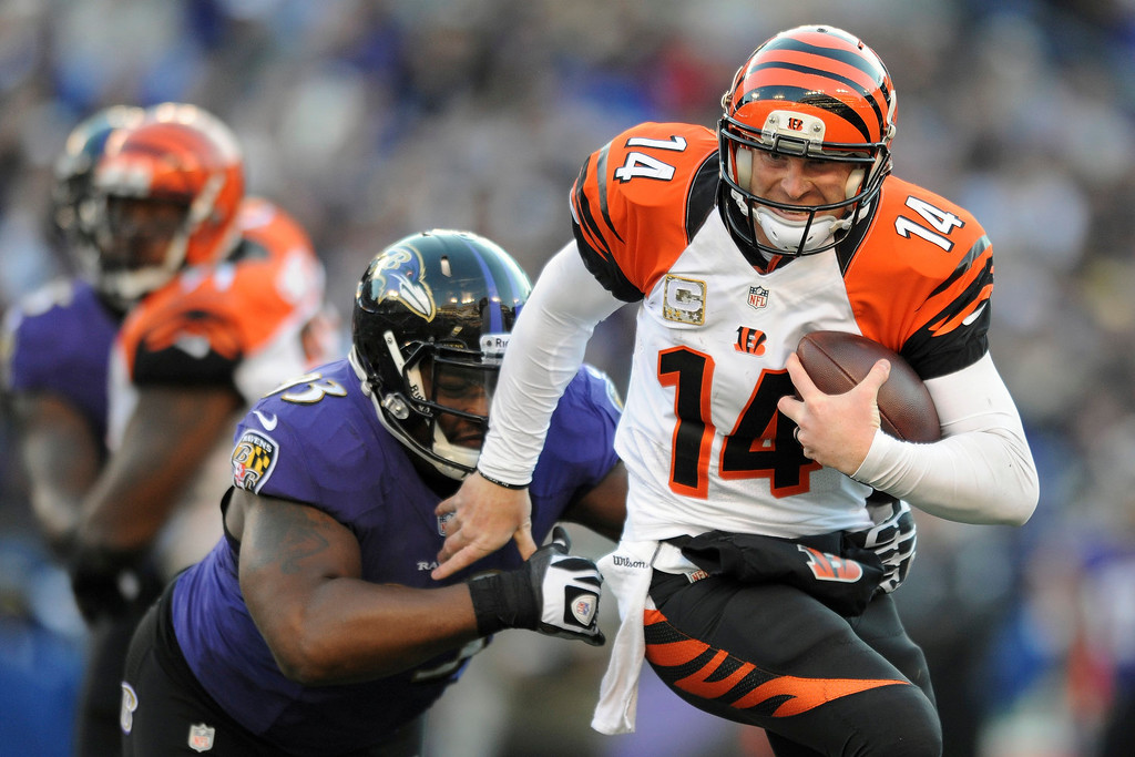 . Cincinnati Bengals quarterback Andy Dalton is sacked by Baltimore Ravens defensive end DeAngelo Tyson during the second half of a NFL football game in Baltimore, Sunday, Nov. 10, 2013. (AP Photo/Gail Burton)
