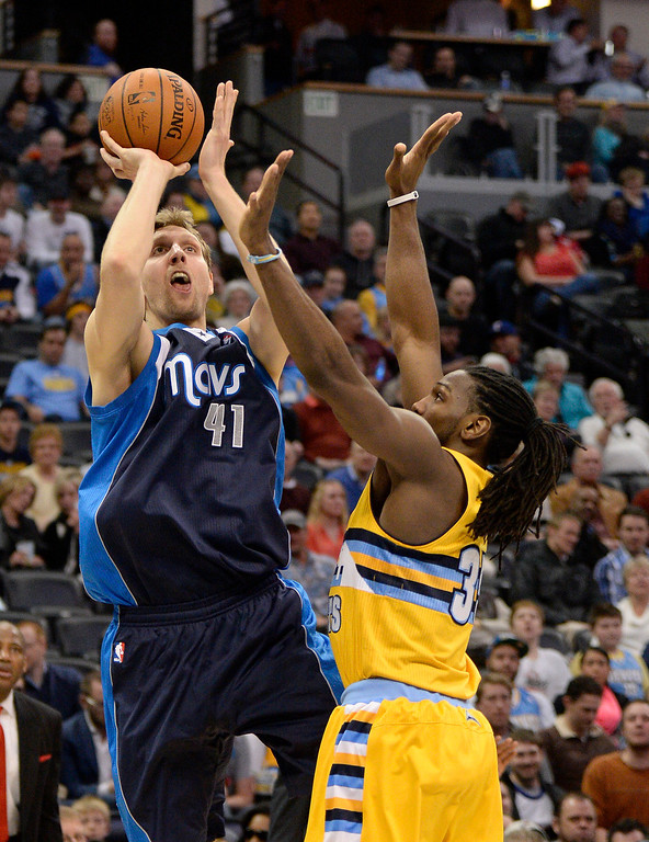 . Dallas Mavericks power forward Dirk Nowitzki (41) takes a shot over Denver Nuggets power forward Kenneth Faried (35) March 5, 2014 at Pepsi Center. The Denver Nuggets defeated the Dallas Mavericks 115-110. (Photo by John Leyba/The Denver Post)
