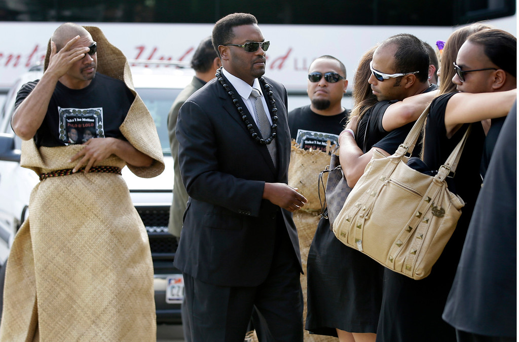""". David Eteaki, left, looks on as Texas A&M  football head coach Kevin Sumlin, center, family, and members of his team are greeted at a receiving line before the start of a funeral service for redshirt freshman Polo Manukainiu and his brother Andrew Uhatafe, at the Church of Jesus Christ Of Latter Day Saints, Saturday, Aug. 10, 2013, in Colleyville, Texas. The two were killed in a single car accident in Northern New Mexico, July 29. Also killed was 18-year-old Utah recruit Gaius \""""Keio\"""" Vaenuku. (AP Photo/Tony Gutierrez)"""