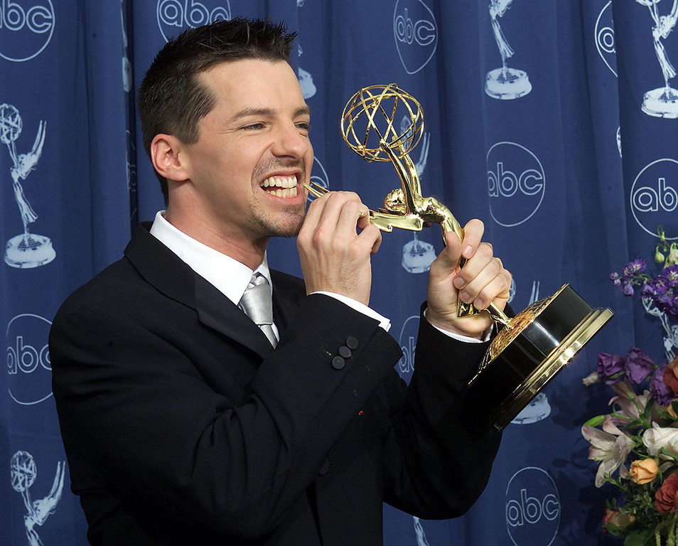 ". Actor Sean Hayes hold his trophy for ""Supporting Actor in a Comedy Series\"" category for his role in \""Will and Grace\"" during the 52nd Annual Primetime Emmy Awards at the Shrine Auditorium in Los Angeles 10 September, 2000.   Scott Nelson/AFP/Getty Images"