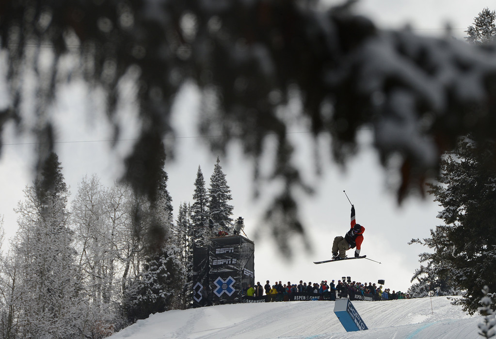 . ASPEN, CO. - JANUARY 27: Andreas Hatveit flies high during the Ski Slopestyle Men\'s Final, January 27, 2013. The 2013 Winter X Games at Buttermilk Mountain in Aspen. (Photo By RJ Sangosti / The Denver Post)