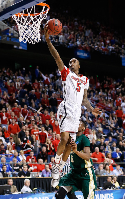 . LEXINGTON, KY - MARCH 23: Kevin Ware #5 of the Louisville Cardinals drives to the basket against Jon Octeus #5 of the Colorado State Rams in the first half during the third round of the 2013 NCAA Men\'s Basketball Tournament at Rupp Arena on March 23, 2013 in Lexington, Kentucky.  (Photo by Kevin C. Cox/Getty Images)