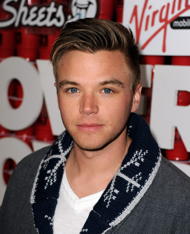 ". Actor Brett Davern arrives at the premiere of Relativity Media\'s ""21 And Over\"" at the Village Theatre on February 21, 2013 in Los Angeles, California.  (Photo by Kevin Winter/Getty Images)"