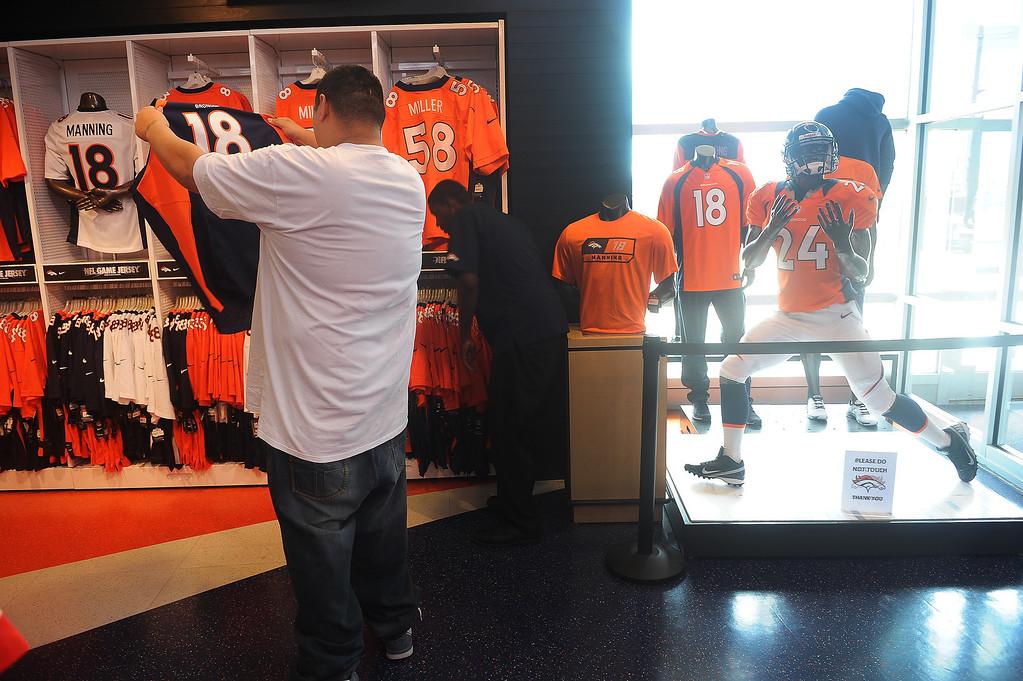 . Andrew Ybarra, of Denver,  shops for Denver Broncos merchandise at the Denver Broncos Team store at of Sports Authority Field at Mile High  in Denver.  Photo by Helen H. Richardson/The Denver Post