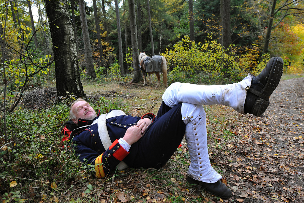 . A member of a local historical society dressed as a soldier of the 8th Artillery Regiment, 5th Division Dufour serving under Napoleon has a break during their four-day march to Leipzig on October 14, 2013 in Schellenberg, Germany. (Photo by Matthias Rietschel/Getty Images)