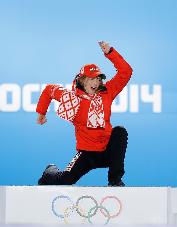 . Women\'s biathlon 15K individual gold medalist Darya Domracheva of Belarus celebrates during the medals ceremony at the 2014 Winter Olympics, Saturday, Feb. 15, 2014, in Sochi, Russia. (AP Photo/David J. Phillip )