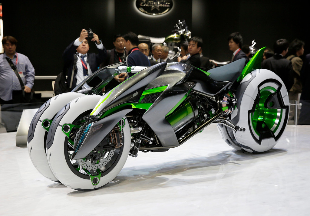 . Kawasaki Motors introduces the electric tricycle J at the 43rd Tokyo Motor Show 2013 in Tokyo, Japan, 20 November 2013.   EPA/KIMIMASA MAYAMA
