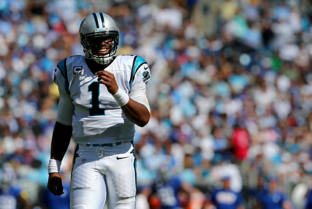 . Cam Newton #1 of the Carolina Panthers walks down the field against the New York Giants during their game at Bank of America Stadium on September 22, 2013 in Charlotte, North Carolina.  (Photo by Streeter Lecka/Getty Images)